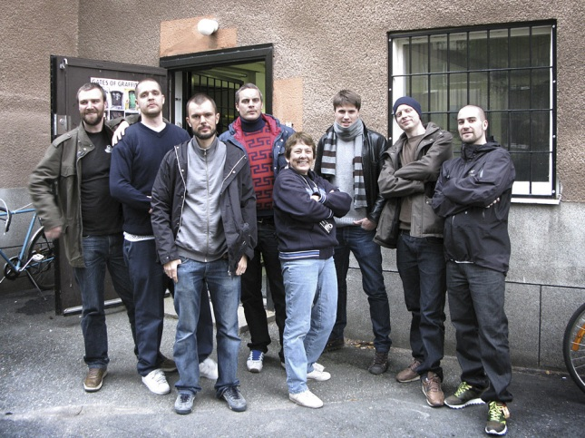 """Dokument&Martha_Cooper"""" From left to right: Jacob Kimwall, Björn Almqvist, Malcolm Jacobson, Tobias Barenthin Lindblad, Martha Cooper, Per Englund, Torkel Sjöstrand, Andreas Nejström. Outside Dokument Press' office. From 2007 when Martha was here, working on her book Tag Town. Photo: Paola Langdal"""