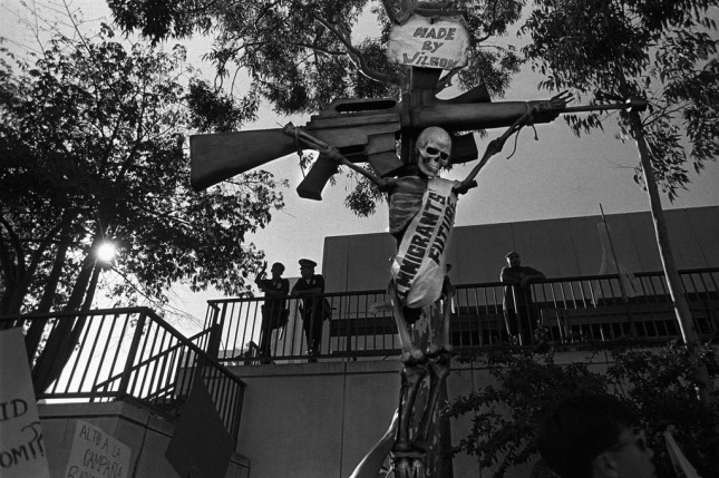 Downtown, Los Angeles, 1994. Immigrants protest Proposition 187, a ballot initiative to deny education and healthcare to undocumented adults and children. It was ultimately defeated, but marked hardening attitudes towards immigrants and their children. Photos by Donna De Cesare. From the book Unsettled/Desasosiego © 2013 by The University of Texas Press.