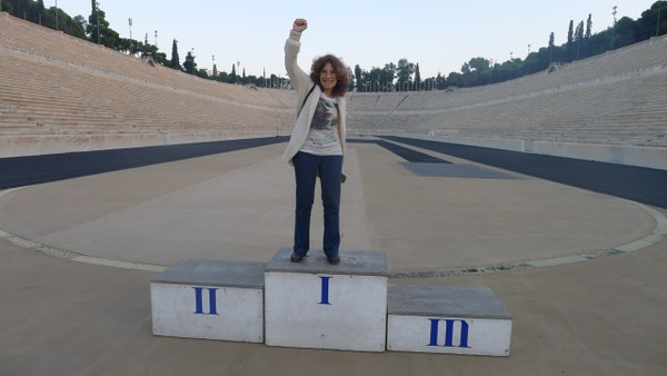 Gail Buckland at the stadium built in Athens in 1896 for the modern Olpymics< Getting in the mood for her next book Who Shot Sports: A Photographic History 1843 to the Present