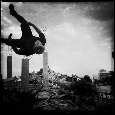 A member of the Gaza Parkour Team exercises among the debris in Khuza'a in Khan Yunis, one of the most damaged areas by Israel Defense Forces during the summer's 50-day war. Parkour is a dramatically growing sport in Gaza. The concept is to move freely and overcome boundaries and barriers, as most Palestinians cannot move freely out of Gaza.