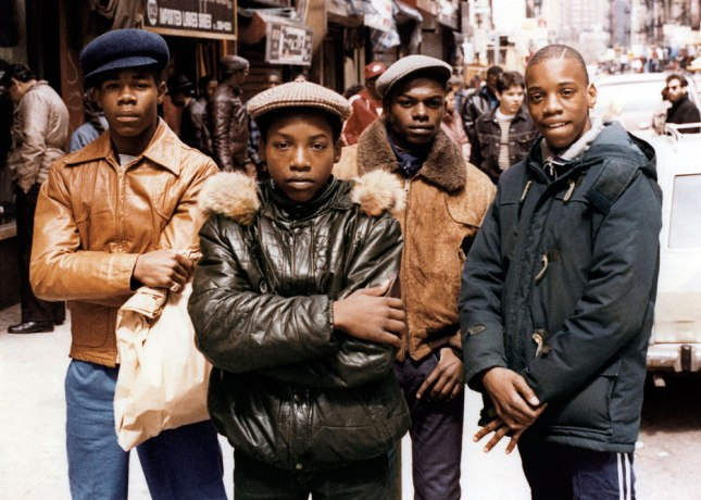 Portrait of four young men on a crowded street on the Lower East Side, New York, New York, 1982