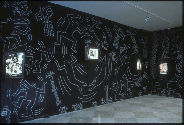 Installation shot of Keith Haring and Tseng Kwong Chi at Semaphore EAST, October, 1984. Photograph courtesy of Barry Blinderman
